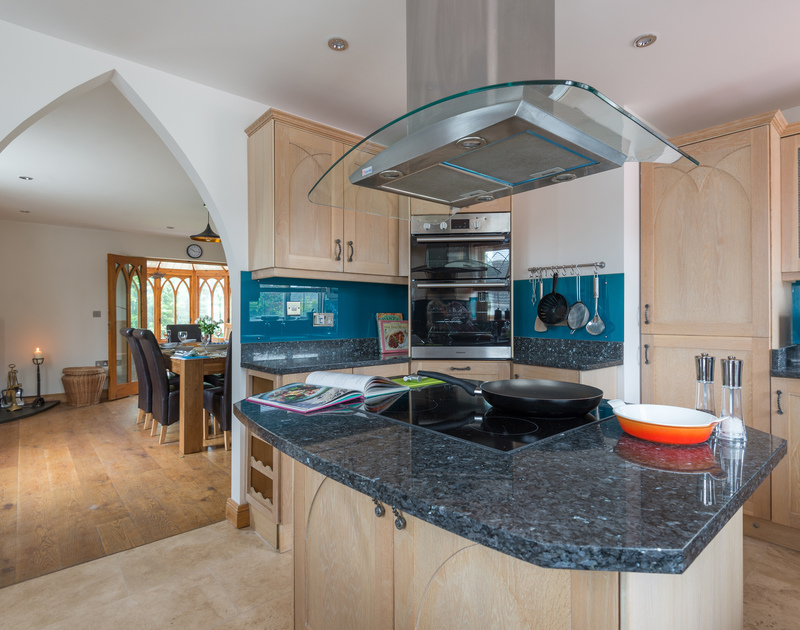 The kitchen island in the spacious kitchen at Fairholme, a self catering holiday house at the top of the pretty harbour village of Port Isaac in Cornwall.