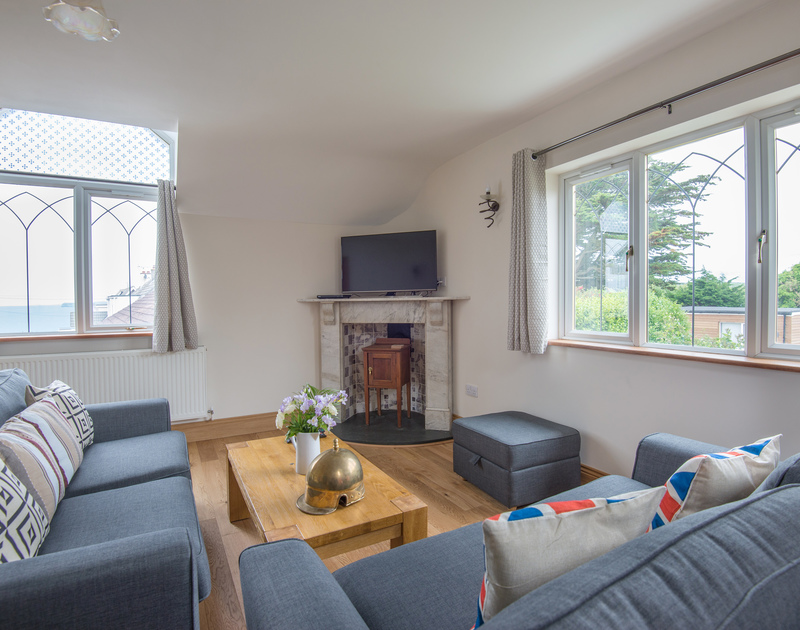 Enjoy the sea and coastline views or cuddle up and watch a movie in the sitting room at Fairholme, a comfortable, self catering holiday house at the top of Port Isaac in North Cornwall.