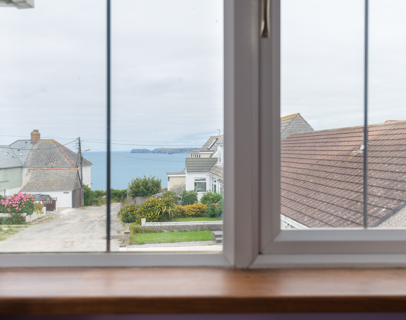 Enjoy the views across the sea and along the coastline from the sitting room at Fairholme, spacious, self catering holiday accommodation in Port Isaac.
