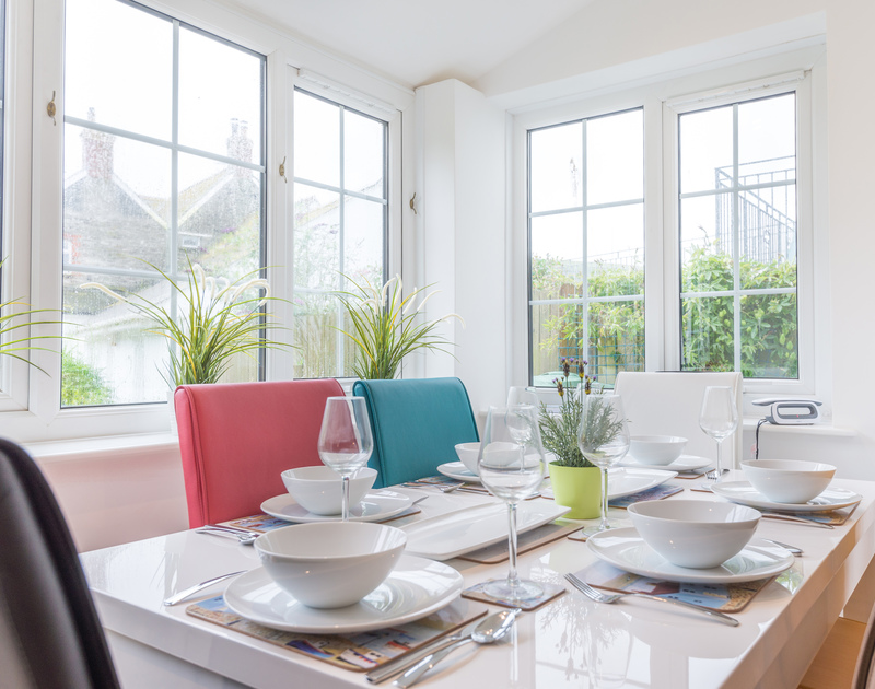 Natural light over the dining table in the open plan kitchen/dining/living room at Beehive Cottage, a contemporary holiday home in Port Isaac, North Cornwall.