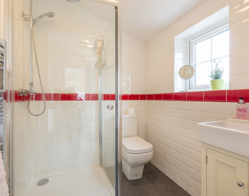 The fully tiled shower room on the ground floor at Beehive Cottage, a self catering holiday retreat to rent in Port Isaac.
