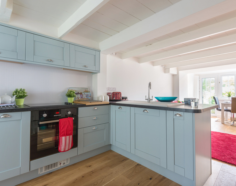 The new shaker style kitchen at Beehive Cottage, a self catering holiday rental just a minutes walk from the vibrant village and Port Isaac's fishing harbour.