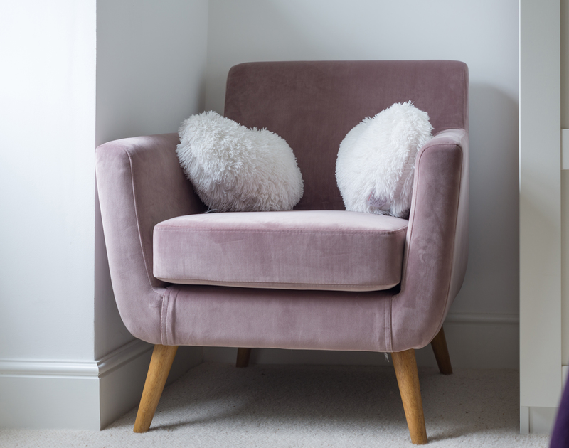 Gorgeous, velvet dusky pink armchair in recently refurbished, stylish and contemporary Beehive Cottage, a self catering holiday retreat for up to four guests in Port Issac in North Cornwall.
