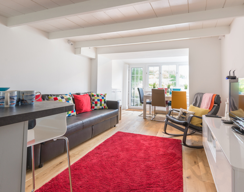 Open plan living in the recently refurbished self catering coastal style holiday home Beehive Cottage to rent in Port Isaac in Cornwall.