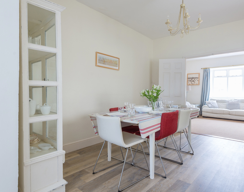 The dining table in the open plan kitchen/diner in Musters, a holiday house to rent in Rock, Cornwall.