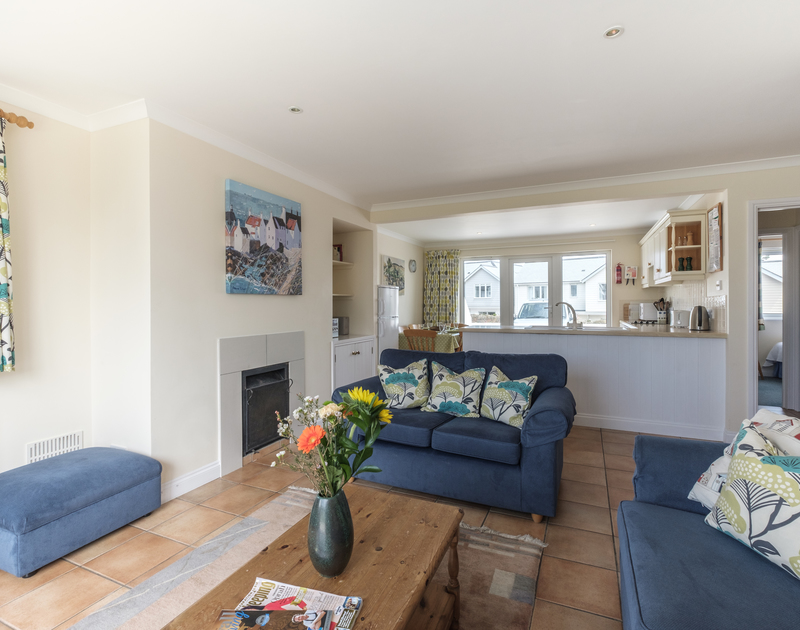 Relax on one of the sofas in open plan St Breock, a well positioned holiday property on the north Cornish coastline.