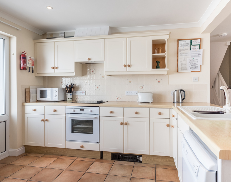 The light well equipped kitchen in St Breock, a self catering holiday cottage to rent close to the sea in Polzeath, North Cornwall.