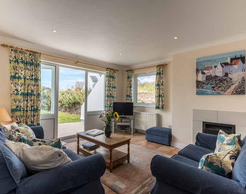 The bright sitting room in St Breock, a self catering holiday cottage to rent in Polzeath, North Cornwall.