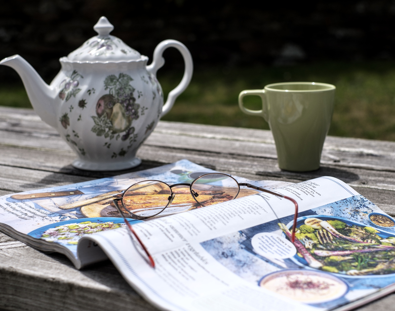 Steal a peaceful moment in the garden with a magazine and a cuppa at coastal, holiday house St Breock in Polzeath.
