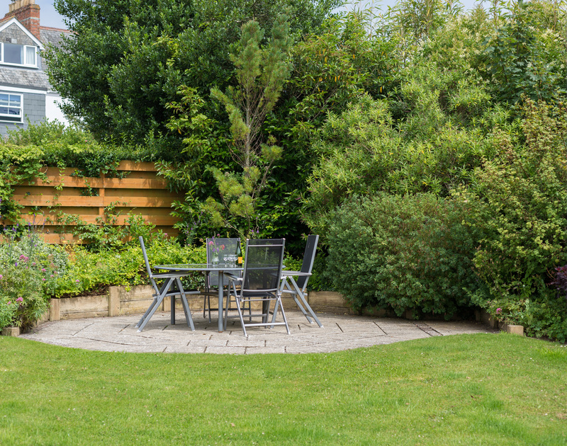 The lawn at Curlew has a paved, sheltered patio area in the corner, ideal for an evening drink or two.