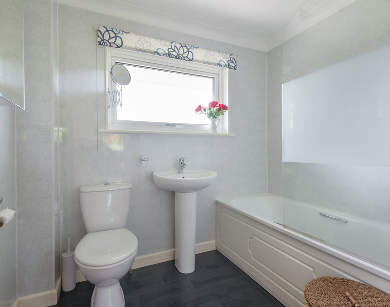 The family bathroom at self catering, holiday home Curlew in Rock, North Cornwall.