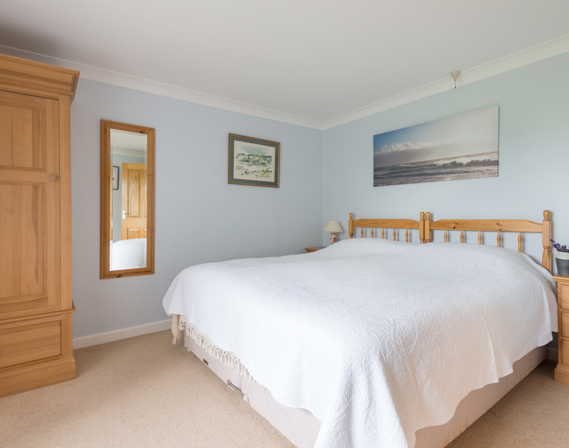 One of the three bedrooms in Curlew has the option of a large 6ft bed or two twin beds.