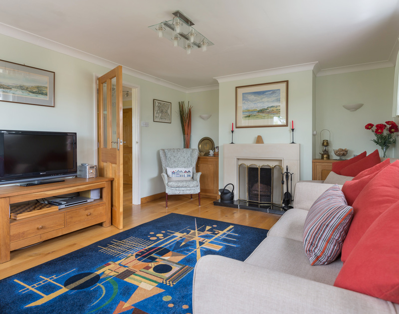 The comfortable sitting room in Curlew, a self catering, holiday home in Rock,North Cornwall.
