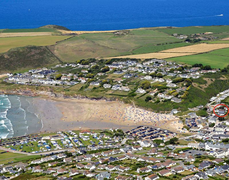 Aerial view of Polzeath on the North Cornish Coast with self catering, chalet style holiday home Sea Reach ringed in red.