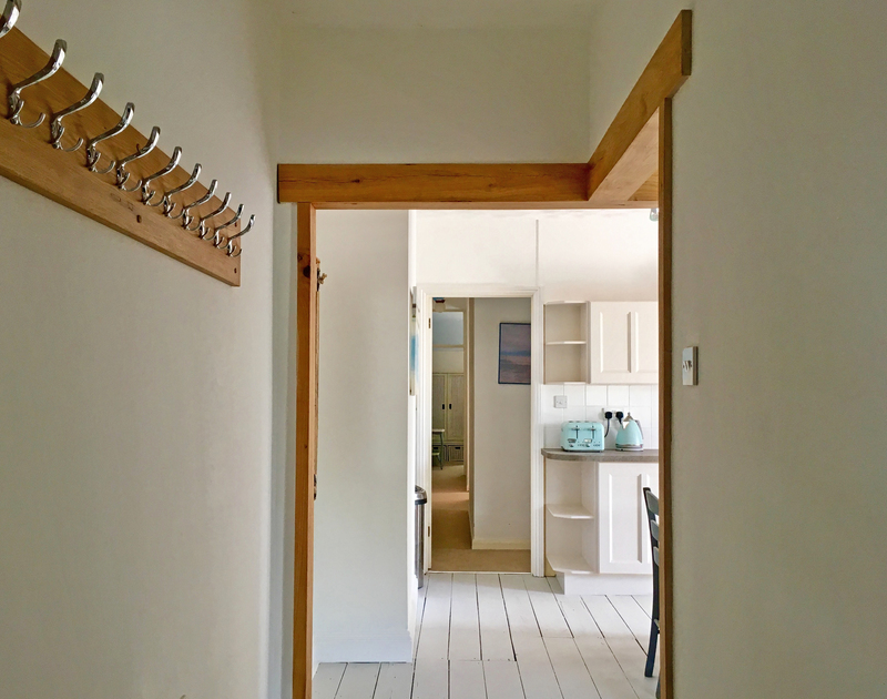 Useful hanging space in the hallway at chalet style self catering, beachside holiday retreat Sea Reach in Polzeath North Cornwall.
