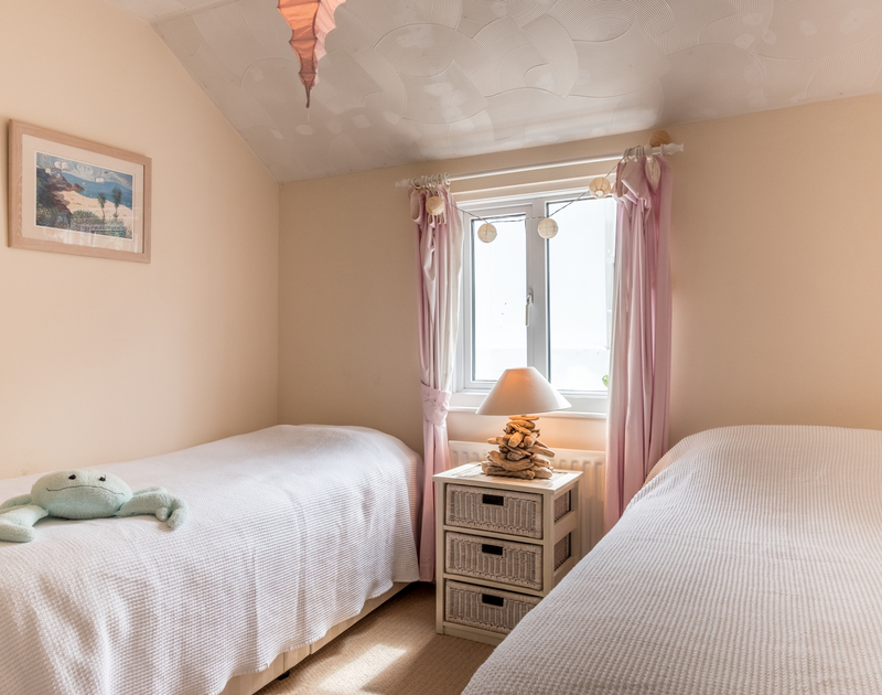 The twin bedroom at Sea Reach, a self catering, chalet style holiday home in Polzeath.