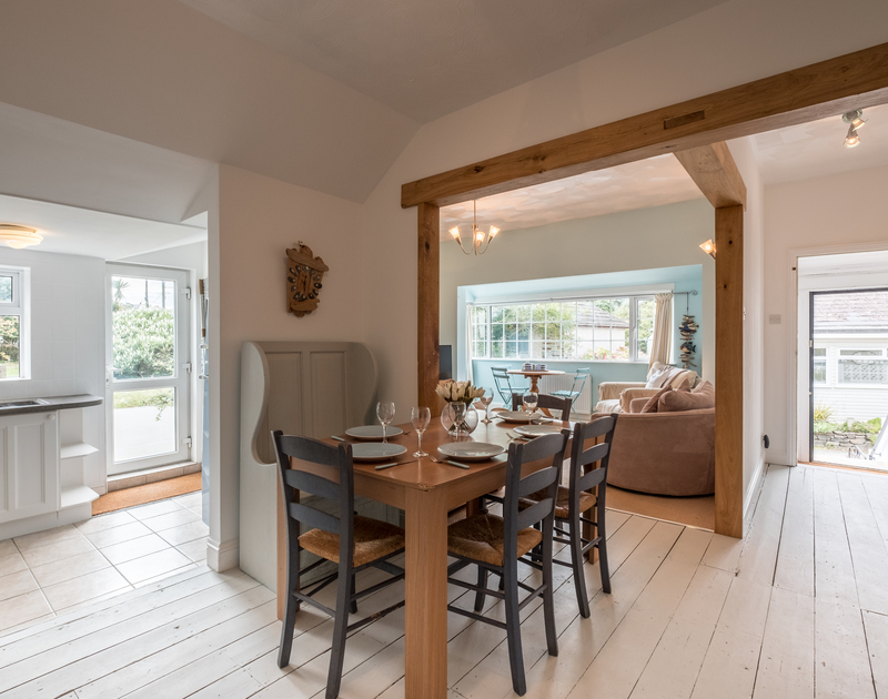 Whitewashed floorboards in the open plan kitchen/living room at self catering holiday retreat Sea Reach in Polzeath.