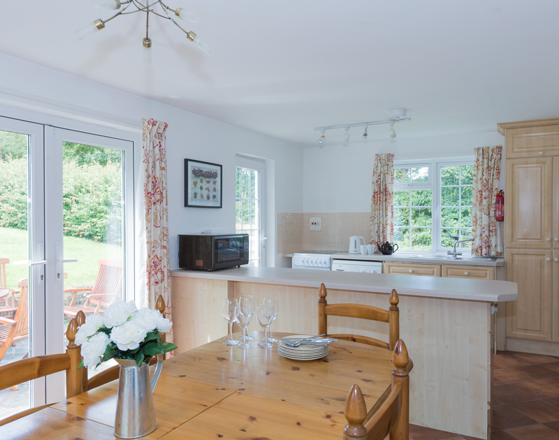 Enjoy family meals together in the light and airy open plan kitchen dining room at The White House in Rock, Cornwall