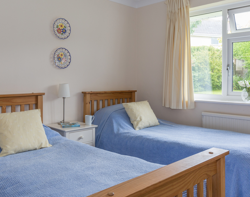 One of two twin bedrooms overlooking the garden, at Guelder Rose in Rock, Cornwall
