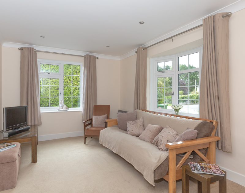 The dual aspect TV room with futon bed at Guelder Rose, a holiday rental in Rock, North Cornwall