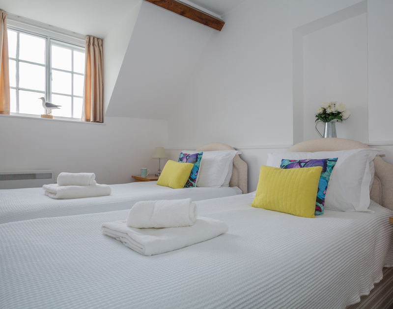 The twin,  zip and link beds at Gully Lofts a holiday cottage in Port Isaac, Cornwall can also be made up as a super king bedroom.