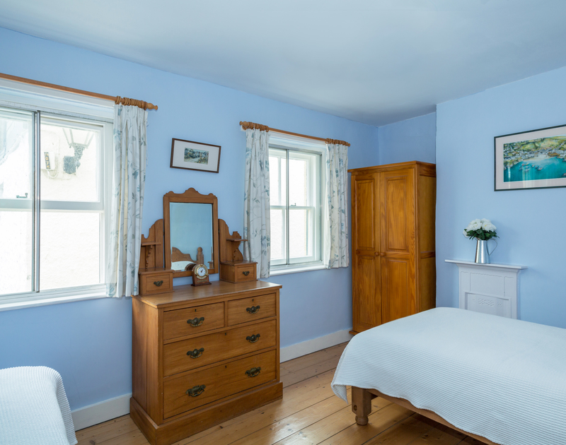A lovely fresh and bright twin bedrooms at Quays Cottage, a holiday cottage in Port Isaac, north Cornwall