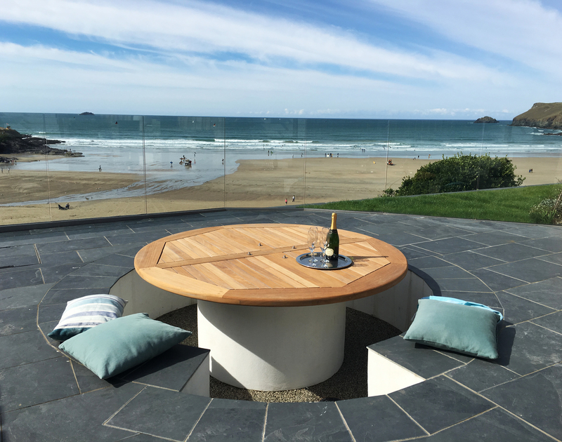 The sunken terrace at The White House in Polzeath has a built in BBQ alongside, providing the perfect spot to watch the tide ebb and flow