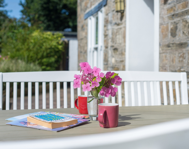 Pick up a book and head outside to the patio table and chairs on the terrace, which makes for a perfect suntrap at Conifers in Rock.