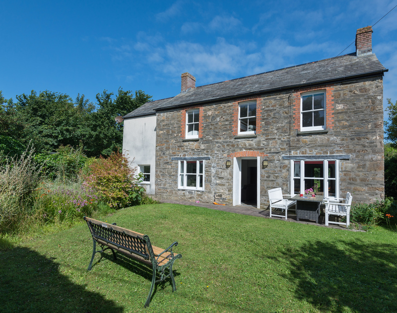 Self catering Conifers, is a good looking, stone holiday cottage set within a pretty garden situated near the top of Rock Road in North Cornwall.