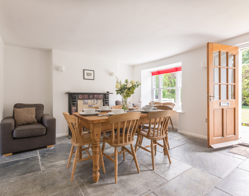 Open the front door at Conifers and step into the slate flagged open plan dining/sitting room in Rock, North Cornwall.