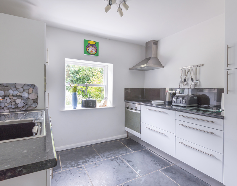 The smart, modern kitchen in Conifers, a self catering holiday rental in Rock, Cornwall.