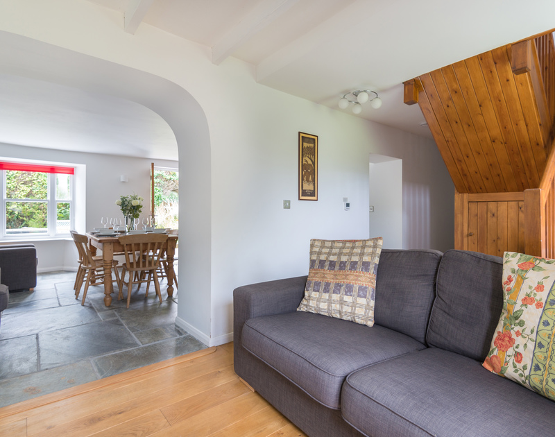 The snug room where the staircase is at Conifers, a self catering, holiday cottage to rent in Rock, Cornwall.