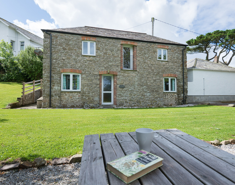 Attractive barn conversion set within its own secluded, private garden An Skyber Barn, a self catering holiday house to rent on the North Cornish coast.