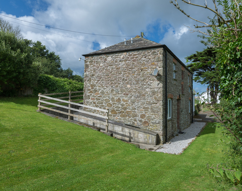 Gorgeous stone walled and slate roofed barn conversion An Skyber Barn in the pretty village of Trelights in North Cornwall.