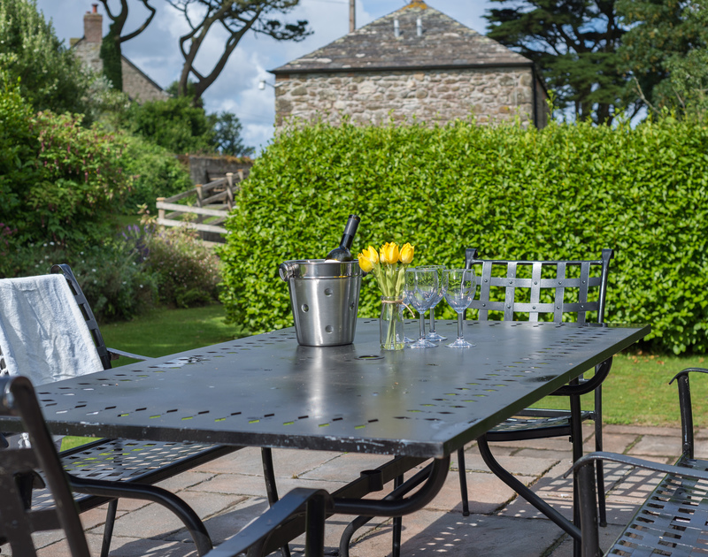 Relax and enjoy a sundowner in the secluded and peaceful garden at An Skyber Barn, a self catering barn conversion for holiday rental in Trelights.