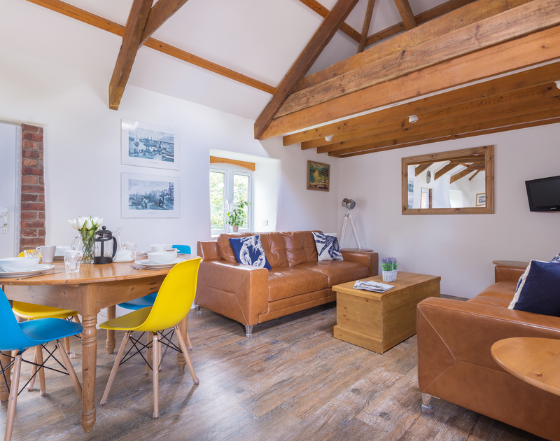 An Skyber Barn has gorgeous exposed beams and a vaulted ceiling making the open plan first floor light and spacious.