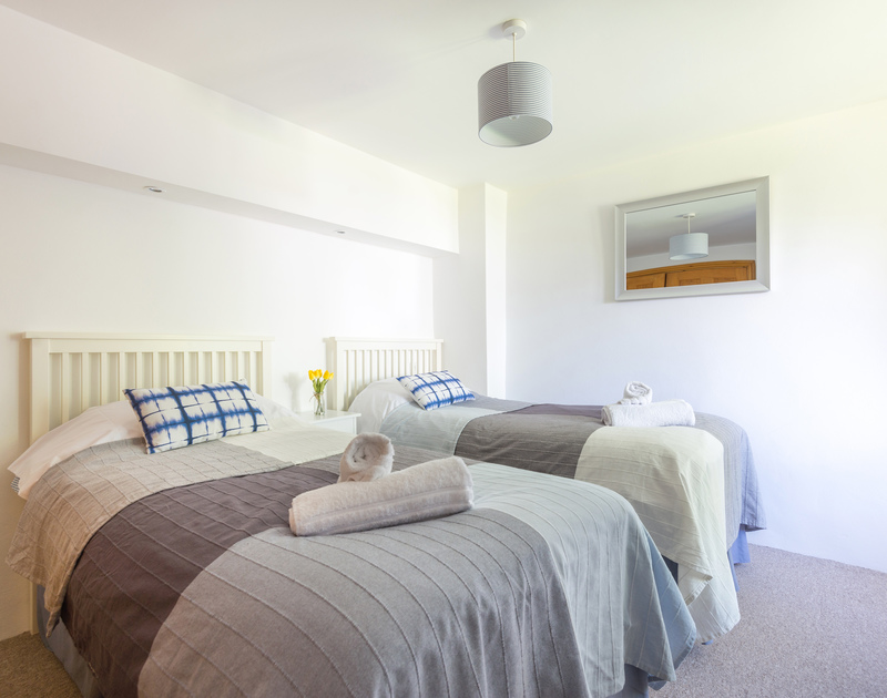 The twin bedroom in An Skyber a converted barn in Trelights near Polzeath, Cornwall