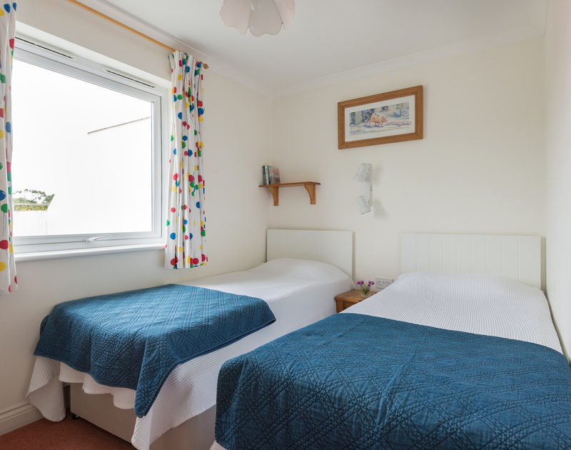 The contemporary style twin bedroom at Kirra, a self catering holiday cottage near Polzeath, Cornwall
