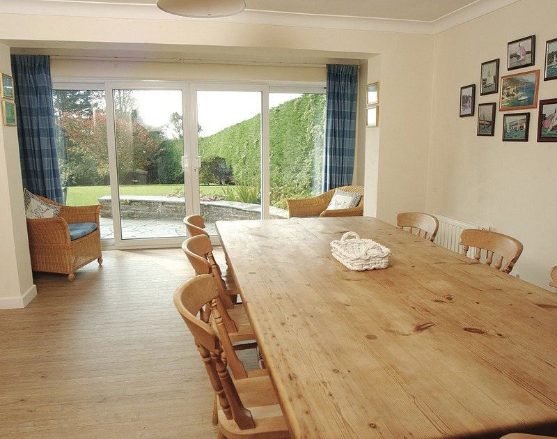 The dining table in the open plan kitchen/diner in Tregillan, a self catering holiday house to rent in Rock, Cornwall.