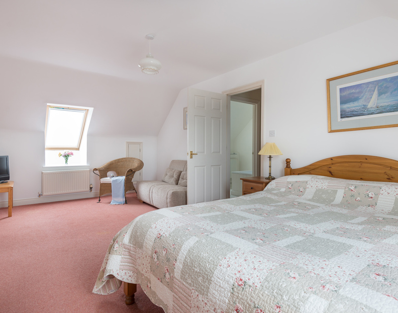 The double bedroom at Kirra, a self-catering holiday house in Polzeath, Cornwall