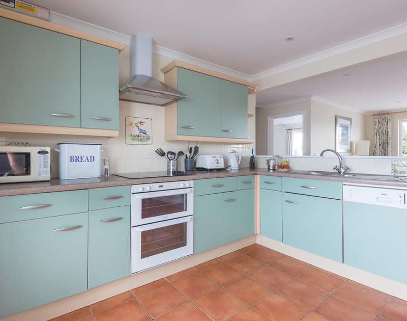 Cook up fresh local produce in the modern kitchen/diner at Kirra, a self-catering holiday rental in Polzeath, Cornwall