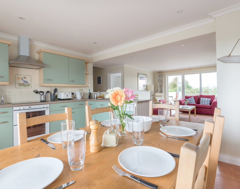Enjoy family meals together in the light and fresh open plan kitchen diner at Kirra,