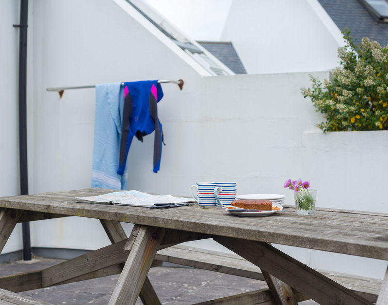 Soak up the sun on the patio of Kirra, a self-catering holiday house in Polzeath, Cornwall