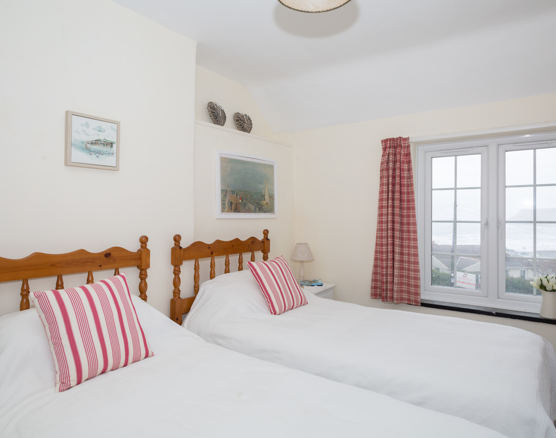 Seaviews from a twin bedroom of Ivy Cottage, a holiday rental in Polzeath, North Cornwall