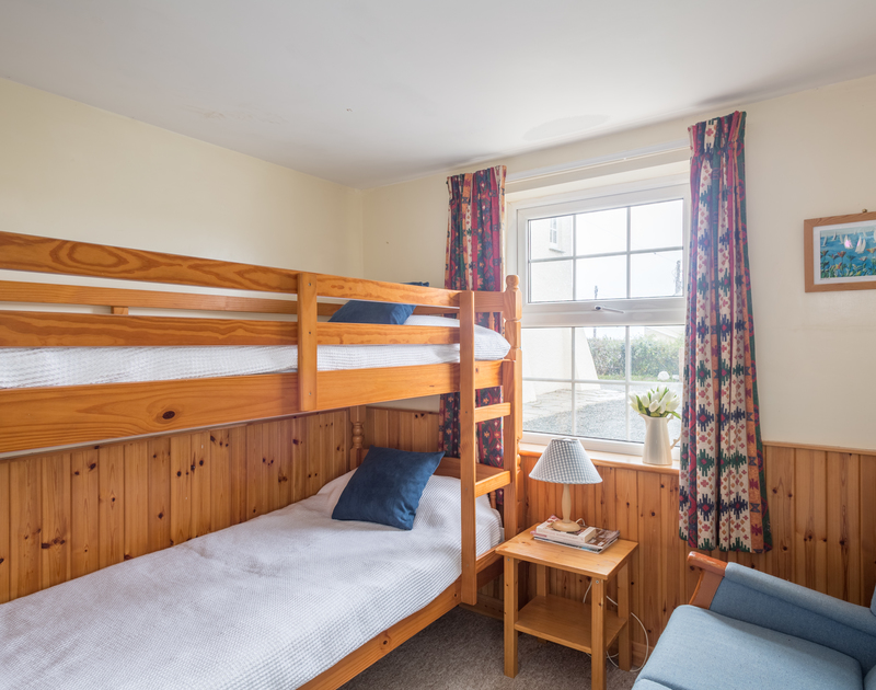 The comfortable children's bunk bedroom in Ivy Cottage located just a minute's walk from Polzeath beach in Cornwall