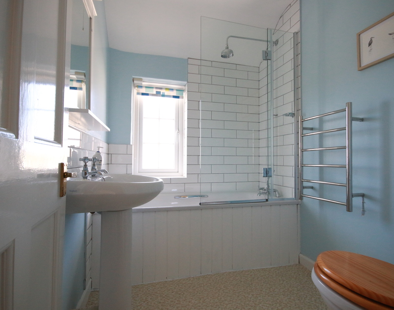 Seaviews from the charming bathroom of Ivy Cottage, a holiday house in Polzeath, Cornwall