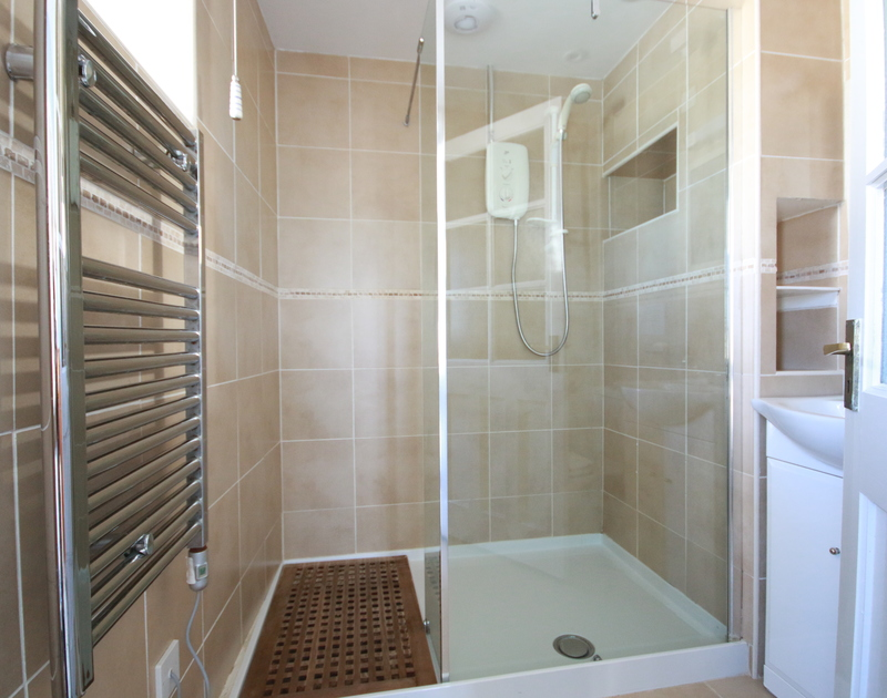 the contemporary style shower room on the ground floor at Ivy Cottage.