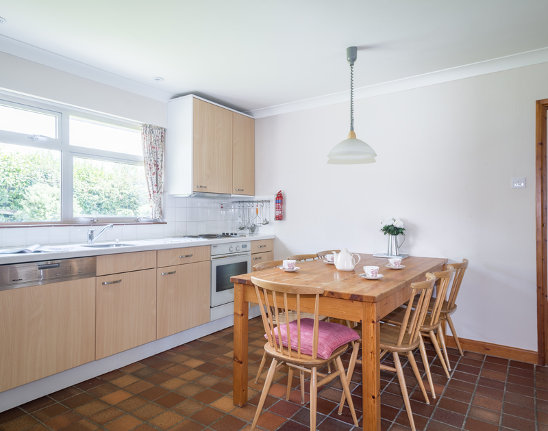 The practical kitchen/diner of Rosevallen, a charming holiday house to rent at Daymer Bay, Cornwall