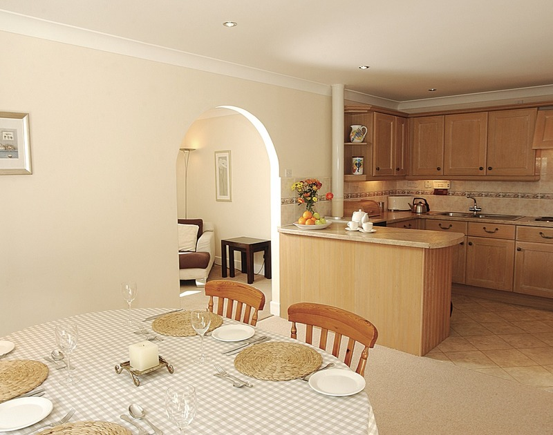 The open-plan dining room of Guelder Rose, a self-catering holiday house in Rock, Cornwall
