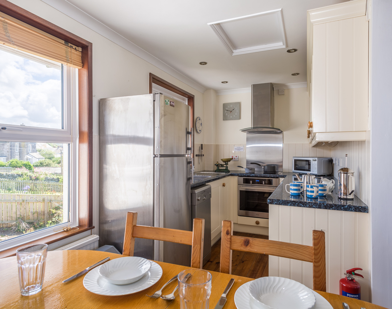 Shaker style units and stainless steel appliances in self catering holiday cottage Shilling Stones Kitchen/dining area in Port Isaac, North Cornwall.